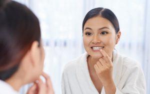 young-woman-checking-teeth